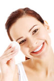 Beautiful woman cleaning her face with cotton pads. Royalty Free Stock Photo