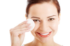 Beautiful woman cleaning her face with cotton pads. Stock Photography