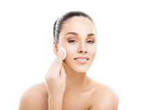 Beautiful woman cleaning her pretty face Stock Images