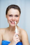 Beautiful woman cleaning her teeth by toothbrush Royalty Free Stock Image