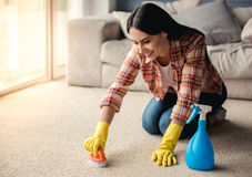 Beautiful woman cleaning house Royalty Free Stock Photo