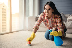 Beautiful woman cleaning house Royalty Free Stock Image