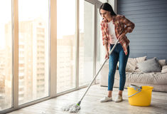 Beautiful woman cleaning house royalty free stock images