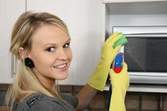 Beautiful Woman Cleaning Kitchen Stock Image
