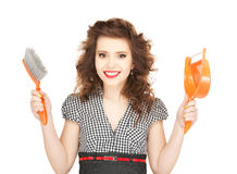 Beautiful woman with cleaning sweep Stock Images