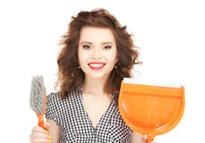 Beautiful woman with cleaning sweep Stock Image