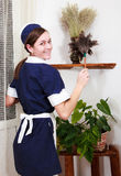 Beautiful woman with cleaning sweep. Picture of beautiful woman with cleaning sweep royalty free stock images