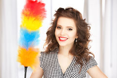 Beautiful woman with cleaning sweep Royalty Free Stock Photos