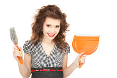 Beautiful woman with cleaning sweep Royalty Free Stock Image