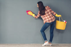 Beautiful woman cleaning stock photos