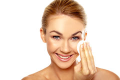 Beautiful woman cleansing her face Stock Photo