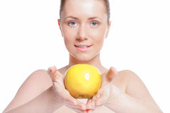 Beautiful woman with clear skin holds apple Royalty Free Stock Photo
