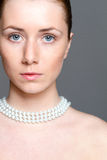 Beautiful woman with clear skin and perl nacklace Stock Photography