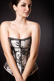 Beautiful woman with cleavage in a corset Stock Photo