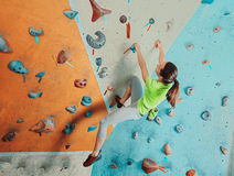 Beautiful woman climbing in gym Royalty Free Stock Photo