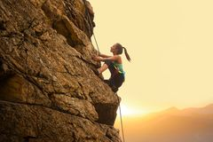 Free Beautiful Woman Climbing On The Rock At Foggy Sunset In The Mountains. Adventure And Extreme Sport Concept Royalty Free Stock Photos - 157507058
