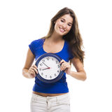Beautiful woman with a clock Stock Image