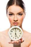 Beautiful woman with clock close up Royalty Free Stock Image