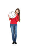 Beautiful woman with the clock. Stock Photography
