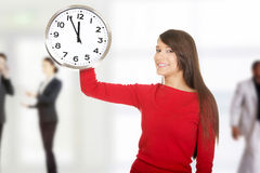 Beautiful woman with the clock. Stock Photos