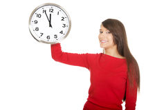 Beautiful woman with the clock. Stock Images