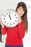 Beautiful woman with the clock. Stock Photo
