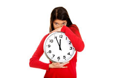Beautiful woman with the clock. Royalty Free Stock Photos