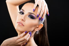 Beautiful woman close up on black background. With purple make up Royalty Free Stock Images