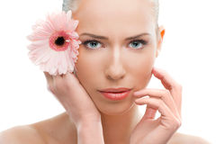 Beautiful woman close up with a flower Royalty Free Stock Photography