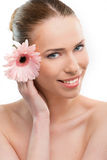 Beautiful woman close up with a flower. On white background stock photos