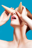 Beautiful woman close up with a ice cream cones, high-quality beauty Stock Photo