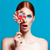 Beautiful woman close up with a lollipop, high-quality beauty Royalty Free Stock Photos