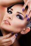 Beautiful woman close up over black background Stock Photos