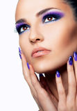 Beautiful woman close up over white background. Make up and nails Stock Images