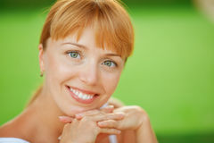 Beautiful woman close up smiles Stock Photos