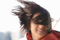 Beautiful woman close-up on a strong wind Royalty Free Stock Photo