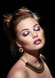 Beautiful woman closed eyes with bright fashion make up Stock Photo