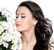 Beautiful woman with closed eyes and flowers Royalty Free Stock Images