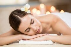 Woman relaxing in spa salon. Beautiful woman with closed eyes relaxing in spa salon Stock Photography