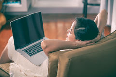 Beautiful woman closed eyes and resting  after work hard with la Stock Photography