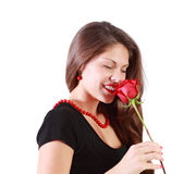 Beautiful woman with closed eyes sniffs red rose Stock Photography