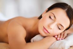 Beautiful woman with closed eyes in spa Stock Photography