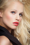 Beautiful Woman. Closeup of gorgeous blond woman with long hair and red lipstick Stock Photos