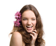 Beautiful woman closeup portrait with flower Stock Image