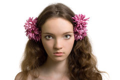 Beautiful woman closeup portrait with flower Royalty Free Stock Photography
