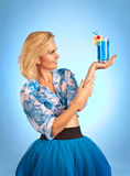 Beautiful woman with cocktail on a blue background Royalty Free Stock Photography