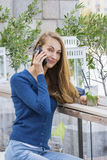 Beautiful Woman with cocktail in cafe mobile phone speaking. Stock Photo