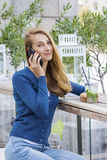 Beautiful Woman with cocktail in cafe mobile phone speaking. Stock Images