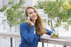 Beautiful Woman with cocktail in cafe mobile phone speaking. Stock Photography