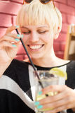 Beautiful Woman with cocktail in cafe Stock Image